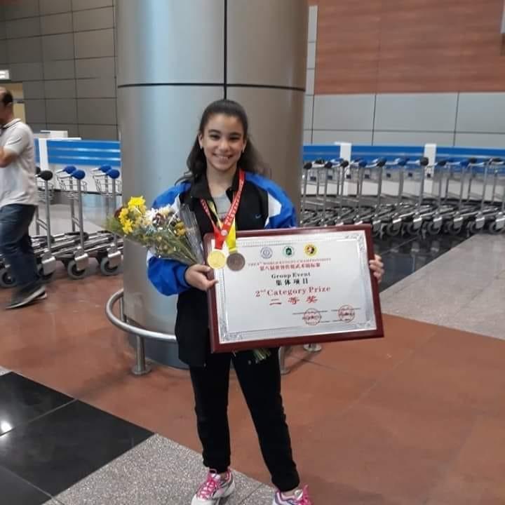 فازت البطلة ملك محمد منتصر،ميداليتين ذهبية وبرونزية في أكبر حدث رياضي للكونغ فو في الصين